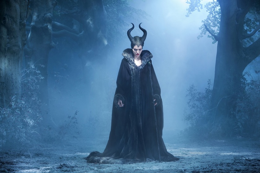 Maleficent alone in the cold darkness of the Moors with covered horns and a heavy cloak upon her once-winged shoulders, projects and embodies the physical, emotional and psychic senses of mourning. © Disney. All rights reserved.